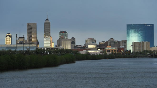 The low sun reflects off the Downtown Indianapolis skyline looking down the White River from New York Street after a storm blew over and the sun emerged from behind the clouds April 29, 2014.