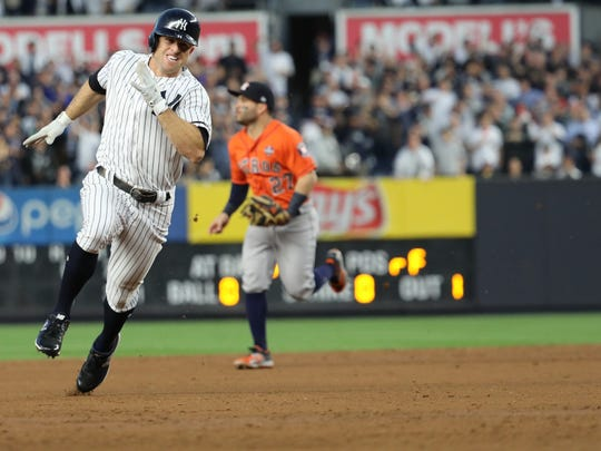 Brett Gardner races home on a double hit by Aaron Judge (not shown) in the third inning of Game 5,  Wednesday, October 18, 2017.