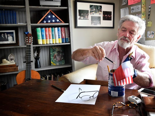Larry Gatlin pulls a special pencil, a Blackwing 602, from its resting place before he begins to write on a blank sheet of paper Tuesday, June 26, 2018, in Nashville.