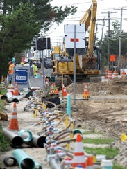 Construction crews work on  a road in Bay Head, N.J.