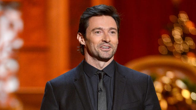 Hugh Jackman speaks onstage at TNT Christmas in Washington 2013 at the National Building Museum on Dec. 15, 2013.
