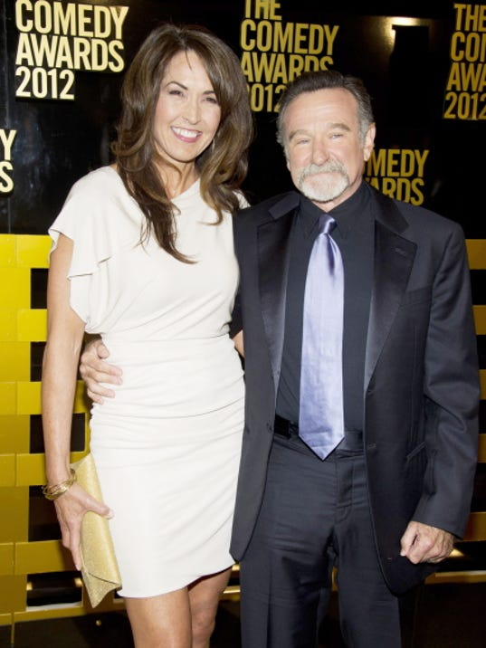 File-This April 28, 2012, file photo shows Robin Williams, left,  and wife Susan Schneider arrive to The 2012 Comedy Awards in New York.