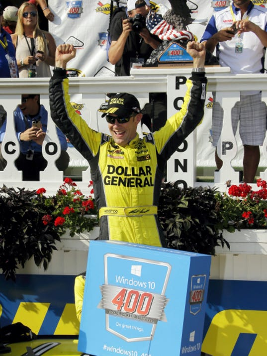Matt Kenseth celebrates in victory lane after winning the NASCAR Pocono 400 auto race on Sunday in Long Pond.