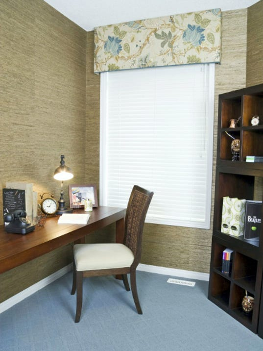 When lighting is sparse in a small room, placing the desk by the single window makes this small home office work efficiently.