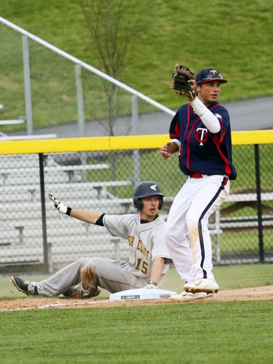 Chambersburg third baseman Bryce Fiegl holds the ball in his glove, and he and Cedar Cliff's Noah Malone look back to the umpire for the call during the Colts' 3-2 victory Friday afternoon.