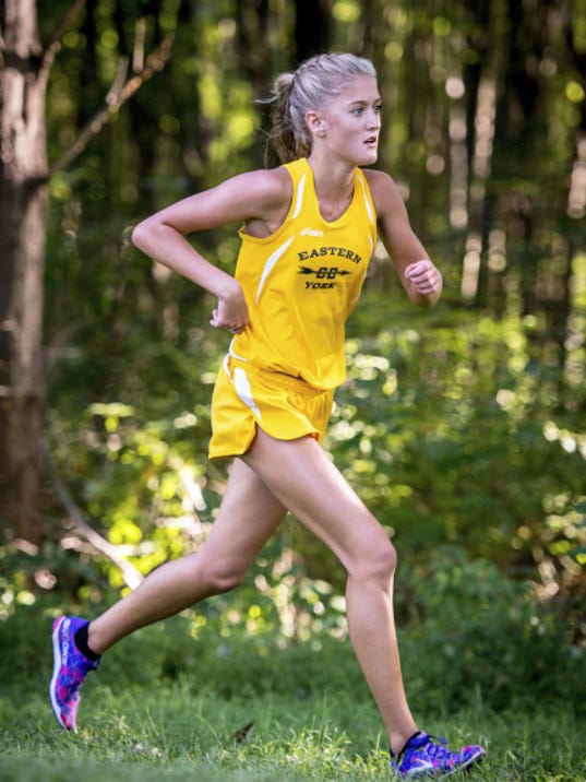 Eastern York's Maddie McLain runs in the first mile of a cross country meet hosted by Delone Catholic at Codorus State Park on Tuesday. McLain finished first in the girl's race, but Eastern's team was narrowly edged by York Suburban overall.