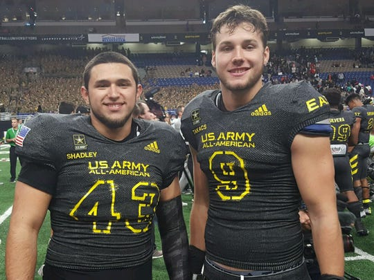 Recent Golden Gate High School graduate Oscar Shadley (left) and recent Gulf Coast graduate George Takacs pose for a photo Saturday, Jan. 6, 2018, following the U.S. Army All-American Bowl. Shadley was the long snapper and Takacs a tight end for the East team.