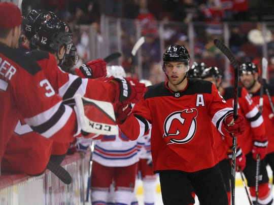 New Jersey Devils left wing Taylor Hall (9) celebrates his goal during the first period of their game against the New York Rangers at Prudential Center.