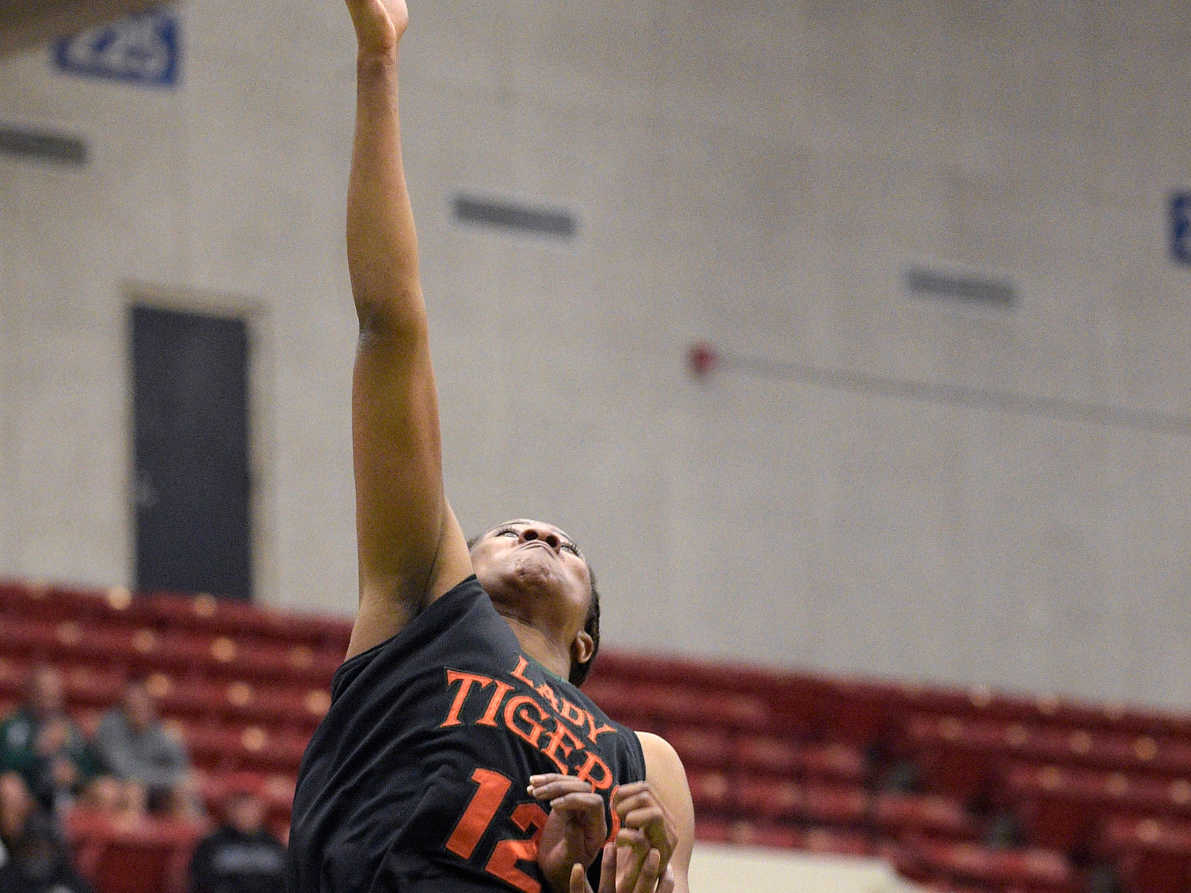 Dunbar's Kiara Desamours (12) puts up a shot in front of Cardinal Newman's Anise Williams, right, during a girls basketball game at the FHSAA State Finals, Tuesday, Feb. 17, 2015, in Lakeland, Fla.(Photo/Phelan M. Ebenhack)