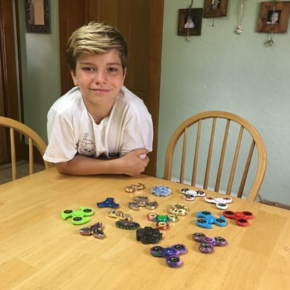 Spinning out of control: Fidget spinners can be helpful and a hindrance in schools