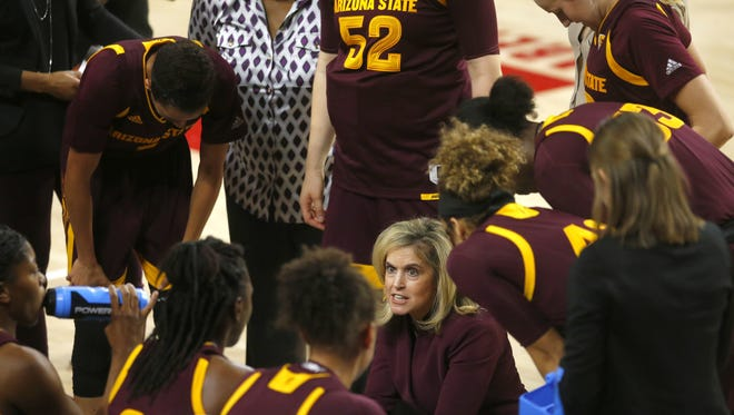 Arizona State Sun Devils head coach Charli Turner Thorne talks to her team during a timeout in a women's basketball game against Sacramento State Hornets at Wells Fargo Arena in Tempe on November 18, 2017.