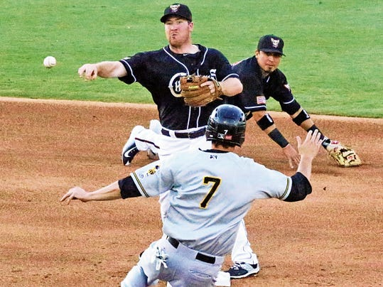 Rudy Gutierrez—El Paso Times Chihuahuas infielder Jedd Gyorko fires to first base and a double play after getting the toss from teammate Ramiro Peña, background, against the Salt Lake Bees Thursday night at Southwest University Park. Sliding into second is Grant Green, 7, of the Bees.