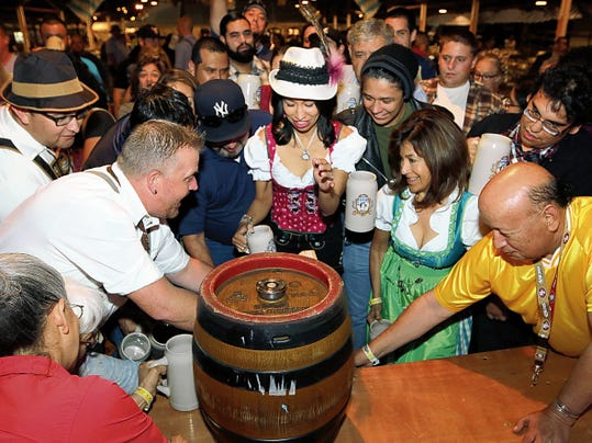"""The first keg of Paulaner Oktoberfest beer is """"tapped,"""" at the El Paso County Coliseum during the first annual Authentic El Paso Oktoberfest. The festival will return to the Coliseum on Sept. 11-13."""