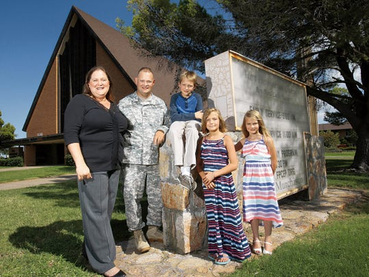 Staff Sgt. John Griffin with his wife, Hope Griffin, and children Ian, 10, Katie, 9, and Alexis, 6, in front of First Presbyterian Church, their place of worship.