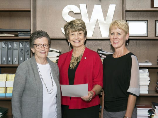 South Western Alumni Association President Pat Loss, left, South Western Superintendent Barbara Rupp, center, and South Western Education Foundation President Betty Carson, right, review an application for the South Western Education Foundation Hall of Excellence. The Hall of Excellence will recognize and celebrate South Western alumni (minimum of 15 years post-graduation is required), who have achieved significant success, have strong moral character, and have excelled in the fields of business, the arts, military, law, education, performing arts, politics, public service, medicine, or athletics. Inductees will be recognized at a celebration planned for late fall.