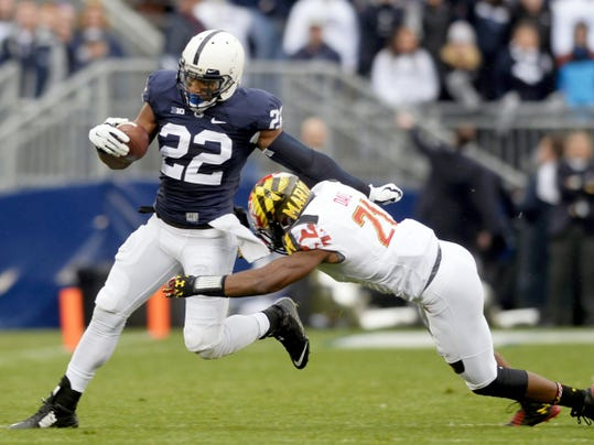 Penn State's Akeel Lynch breaks a tackle against Maryland's Sean Davis during a game last season at Beaver Stadium. Maryland coach Randy Edsall said during Big Ten Media Day on Thursday he views Penn State as his team's rival.