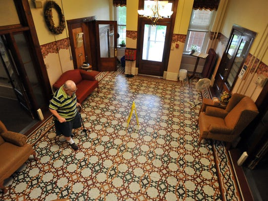 Marty Hammond walks across the main foyer of Fairview Assisted Living, Tuesday, Aug. 12, 2104, in New Lexington. The facility is one of less than 30 county homes still in operation in the state.