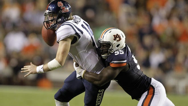 Auburn defensive end Carl Lawson returns from a torn ACL injury that forced him to miss the 2014 season.
