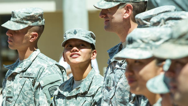 New Mexico State University ROTC Cadet Maj. Krista Gatan looks up and smiles at her fellow Cadet, 1st Sgt. Andrew Leon on Friday, April 15, 2016, during NMSU's second annual Founders Day celebrated at the Traders Plaza on campus. At NMSU and around the country many gather to honor the Army ROTC for its 100 year anniversary.