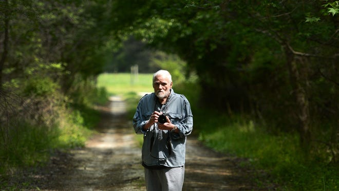 Bates Littlehales poses for a portrait in a wooded area at his home in Keller, Va., on, May 6. Littlehales is a retired National Geographic photographer and still shoots for fun in and around the woods at his home. He also handcrafts and repairs banjos.