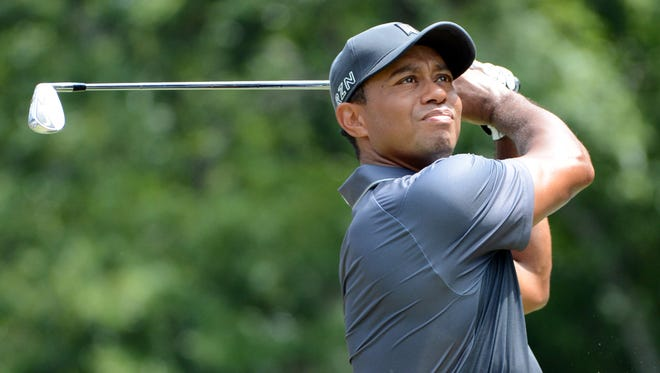 In a file photo from Aug 21, 2015, Tiger Woods watches his approach shot at the Wyndham Championship  at Sedgefield Country Club.