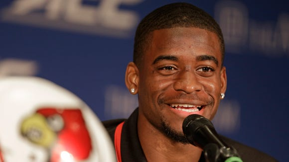 File photo: Louisville's Devante Parker answers a question during a news conference at the Atlantic Coast Conference Football kickoff in Greensboro, N.C., Sunday, July 20, 2014. (AP Photo/Chuck Burton)