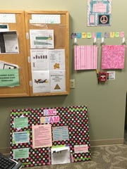 Behind the nurses station on the mother and baby floor at Mercy Medical Center in Des Moines, boards of hospital policies, procedures and encouragements help out the new nurses on staff.