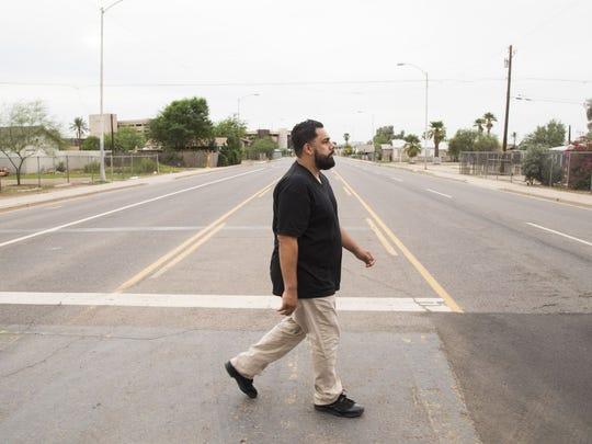 Eddie Martinez walks the streets near Lowell Elementary, Phoenix, October 2015.