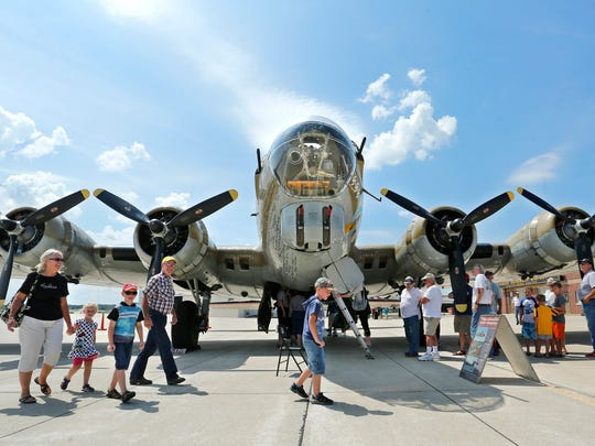 Guests walk beneath the nose of a B-17G Flying Fortress Monday, August , 2016, at the Purdue University Airport. The WWII era plane was part of the Wings of Freedom Tour at the airport.