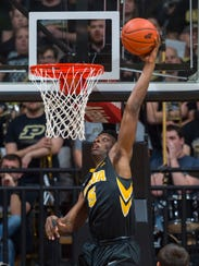 Iowa forward Tyler Cook dunks in the second half against