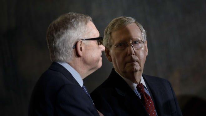 Senate Minority Leader Harry Reid, D-Nev., left, and Senate Majority Leader Mitch McConnell, R-Ky.