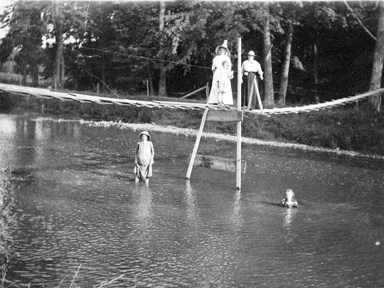 This is the predecessor crossing to the 1913 swinging bridge which crosses the Sheboygan River into River Park in Sheboygan Falls.