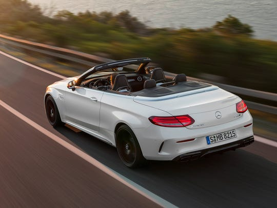 The Mercedes-AMG C 63 S Cabriolet, with diamond white bright exterior, and AMG nappa leather platinium white pearl/black interior.