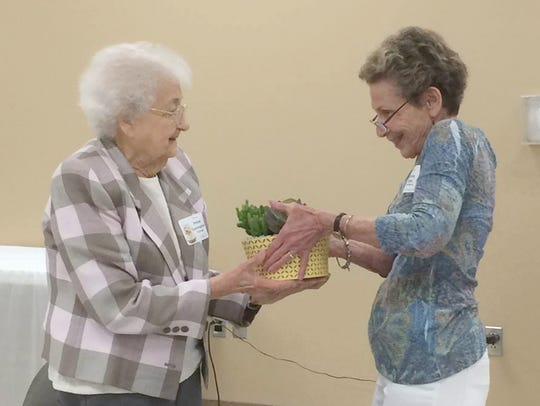 Fairview's Irvine Cunningham accepts a gift from Cyndy