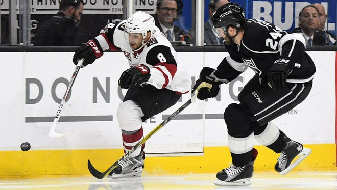 Arizona Coyotes right wing Tobias Rieder (8) and Los Angeles Kings defenseman Derek Forbort (24) battle for the puck in the first period during a NHL hockey game at the Staples Center, Mar. 14, 2017.