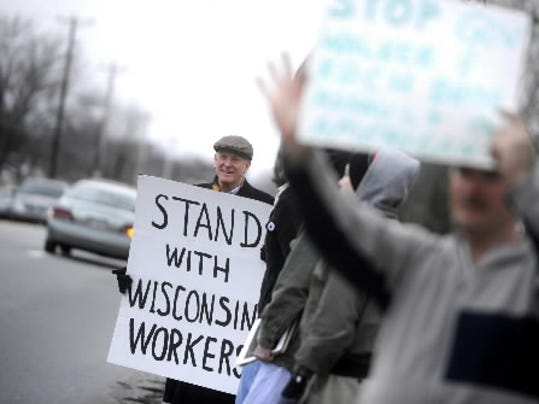 Stephen Baker of Springettsbury Township was among a group organized by the green party to support Wisconsin workers on East Market Street Friday, March 11, 2011. DAILY RECORD/SUNDAY NEWS - KATE PENN