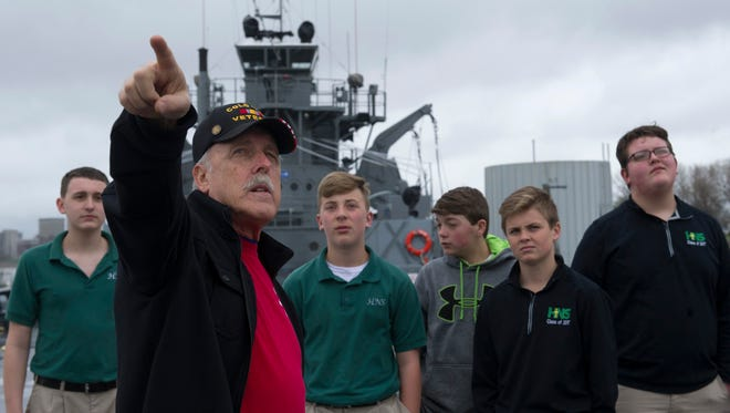 Tom Carr, a U.S. Navy veteran, gives a tour of the LST-325 to Holy Name School students Friday morning.