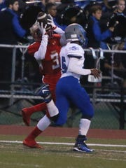 The Eagles of Edison High School take on the Bombers from Sayreville War Memorial High School in a varsity football at Edison on Friday September 16, 2016Edison's # 3 (left) Keaun Reed hauls in a Justin Turner thrown pass for a touchdown during the 1st half of play.