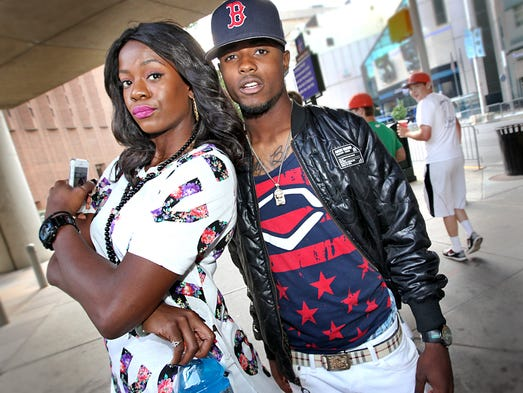 Shyra Ely-Gash with Lavar Reed during the Black Expo street fashion search.
