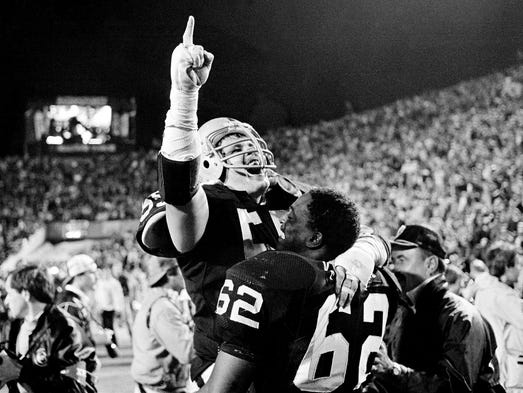 Super Bowl XVIII (Raiders 38, Redskins 9): Los Angeles Raiders linebacker Matt Millen gestures as he celebrates with nose tackle Reggie Kinlaw (62) following their win.