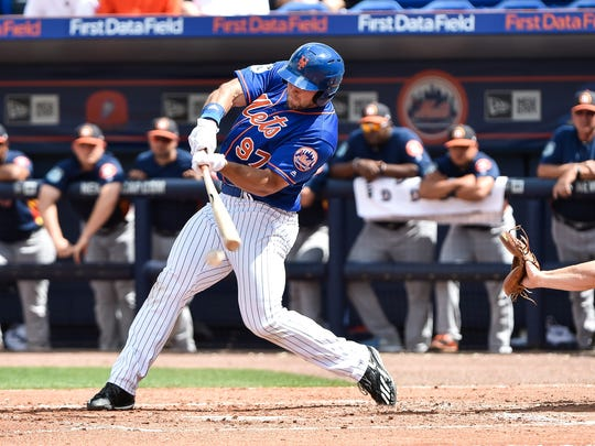 Mets right fielder Tim Tebow (97) grounds out against