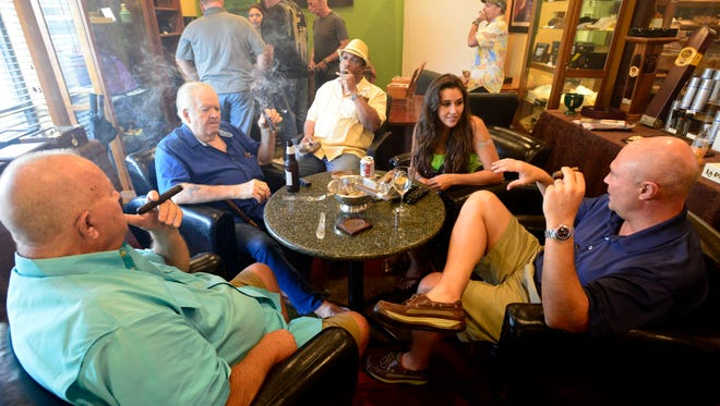 A crowd gathers at Cordova Cigars on Wednesday for a hand rolling demonstration by Azarias Cordoba of Cordoba & Morales Handmade Cigars.