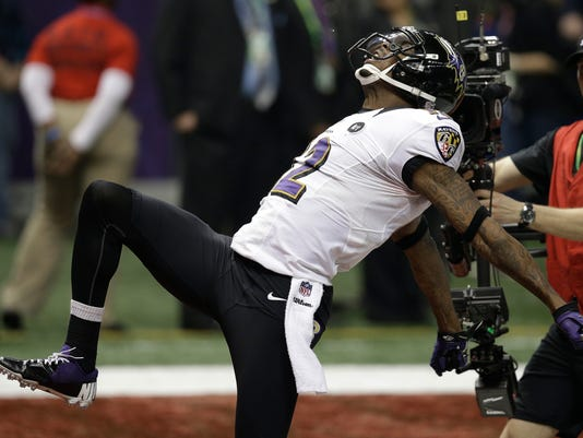 FILE - In this Feb. 3, 2013, file photo, Baltimore Ravens wide receiver Jacoby Jones (12) celebrates after returning a kickoff for a 108-yard touchdown against the San Francisco 49ers during the second half of the NFL Super Bowl XLVII football game, in New Orleans. The Ravens defeated the 49ers 34-31. (AP Photo/Elaine Thompson, File)