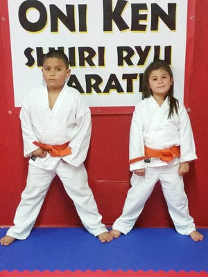 Azian and Avery Castro recently tested for and received their orange belts in Shuri Ryu Karate at the Oni Ken Shuri Ryu Karate school in Silver City. Their instructor is Trent Petty.