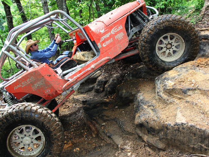Brandon Powell, partner and manager of Southern Missouri Off Road Ranch, located south of Seymour, Mo., navigates up a steep rock hill in his super-modified Jeep.
