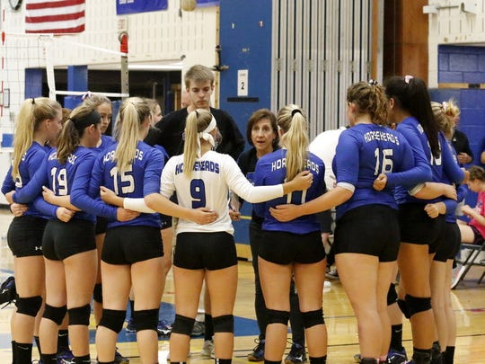Patti Perone huddles with Horseheads during the 2017 Horseheads Volleyball Classic at Horseheads Middle School.