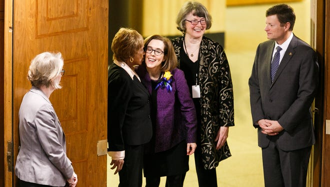 Gov. Kate Brown greets Senator Jackie Winters, R-Salem, before the State of the State address on Monday, Feb. 5, 2018, at the Oregon State Capitol in Salem.