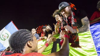 Midfielder Kevon Lambert (27) of Phoenix Rising FC high-fives fans following Phoenix Rising FC's 4-0 win against Las Vegas Lights FC at Phoenix Rising FC Soccer Complex on Wednesday, June 13, 2018 in Tempe, Arizona.