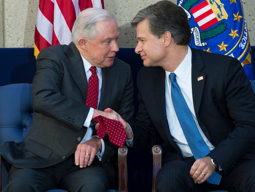 Wray and Attorney General Jeff Sessions shake hands