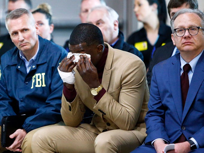 Hero James Shaw wipes tears away during a press conference